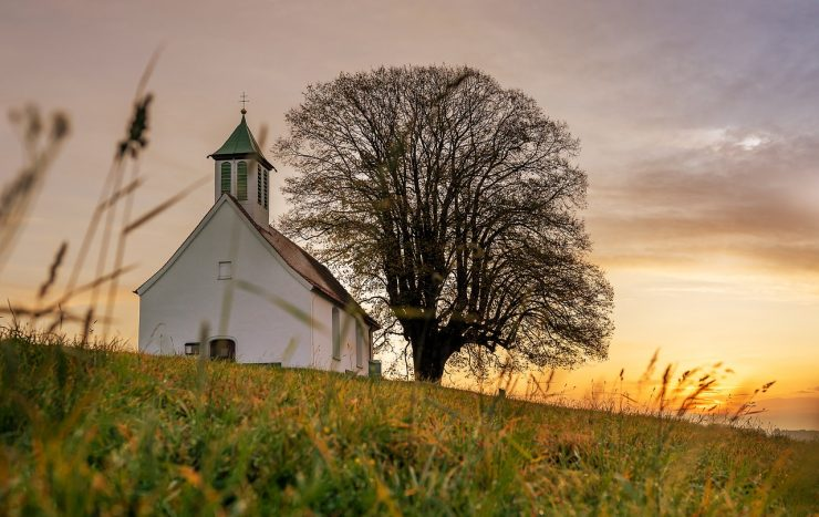 Scripture Talks About Unity in the Body of Christ - Picture of Church on a Hillside